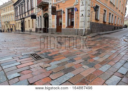 VILNIUS, LITHUANIA - DECEMBER 30, 2016: Colorful cobbled street and facades in the Old Town