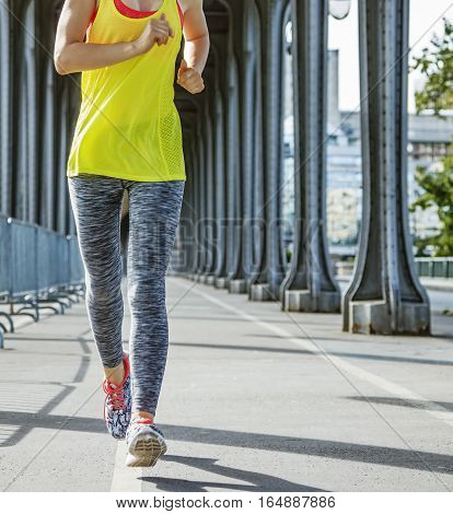 Sportswoman Running On Pont De Bir-hakeim Bridge In Paris
