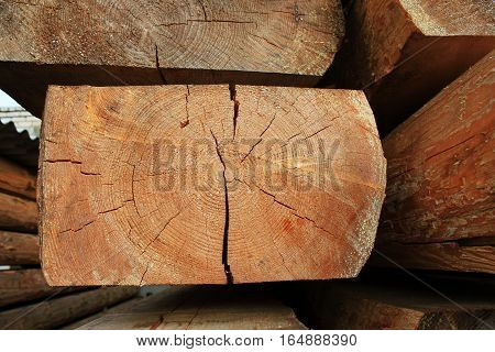Wooden beams - building material of roof , wooden components for carpenter work. Oak background.