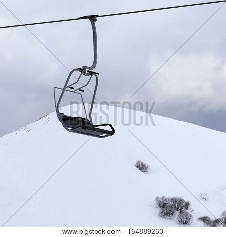 Chair Lift And Gray Sky At Evening