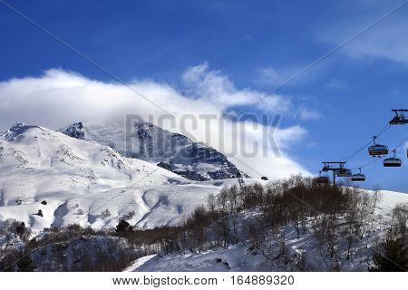 Ski-lift off-piste and mountain in clouds. Caucasus Mountains. Mount Tetnuldi Svaneti region of Georgia.