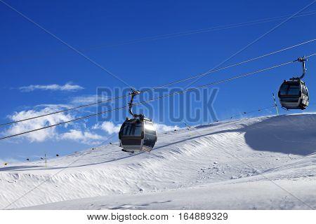 Gondola Lifts On Ski Resort At Sun Wind Day