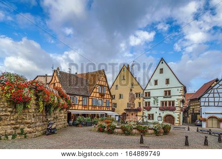 Main square with fountain with statue of pope Leo IX in Eguisheim Alsace France