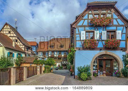 Picturesque historical street in Eguisheim Alsace France