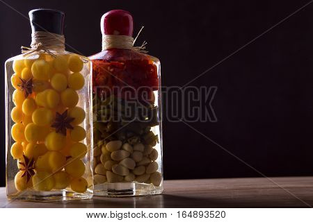 Composition with jars of marinated vegetables. Vegetarian food