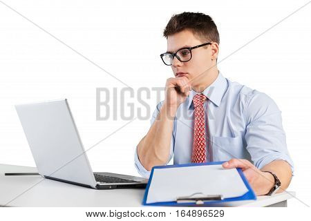 young man looking at a laptop while holding a board