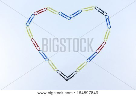 Outline of the hearts from paper clips isolated on white background
