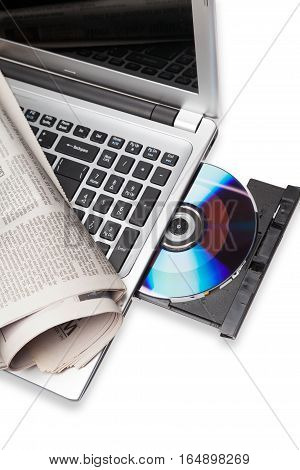 Newspaper Laying on a Laptop with Open CD/DVD Drive