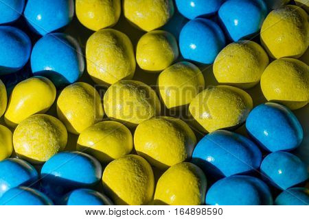 Colorful candy in Swedish colors yellow and blue. Abstract pattern of the Swedish flag.