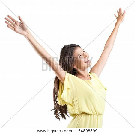 Young woman standing with open arms towards the sky