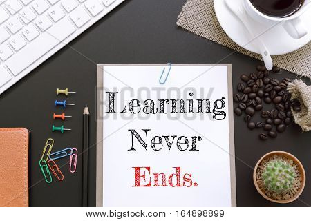 Text Learning never ends on white paper background / business concept