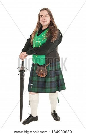 Scottish man in traditional national costume with sword isolated