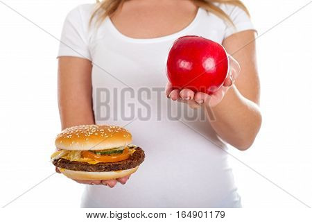 Close up picture of a delicious hamburger in a woman's hands