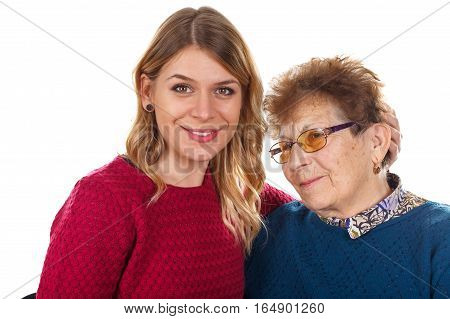 Picture of an elderly woman and her loving granddaughter