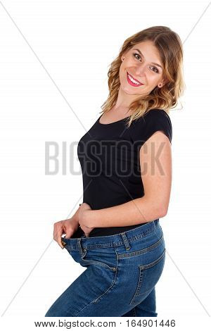Picture of a beautiful woman being happy for her weightloss - isolated background
