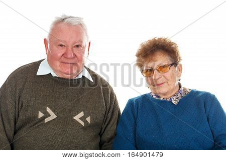 Picture of a happy elderly couple posing on an isolated background