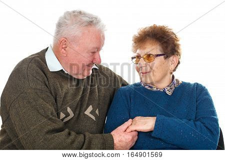 Picture of a married elderly couple posing on an isolated background