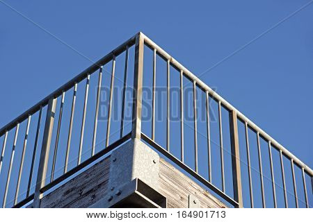 metal parapet railing with background blue sky