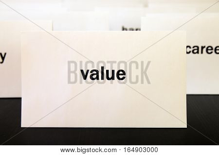 Word Value On A White Paper Card Surrounded By Other Words. Priorities And Values Concept