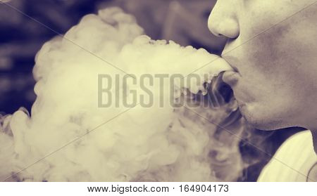 soft focus selection focus area blurred background man smoking : color filter unhealthy concept