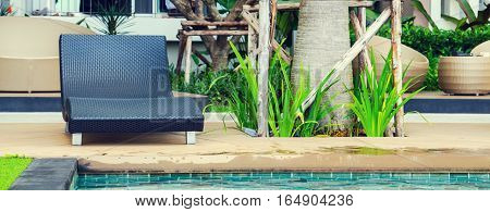 Relaxation with Rattan chair side swimming pool
