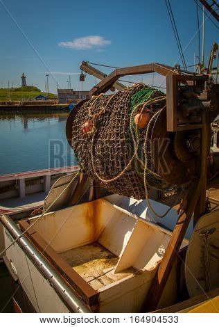 Fishing net and rope at a wharf in pei