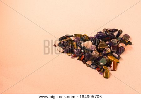 Greeting Card With A Heart Of Colored Semiprecious Stones On A Light Beige Background With Empty Spa