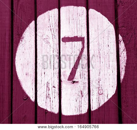 Number Seven On Pink Toned Wooden Wall