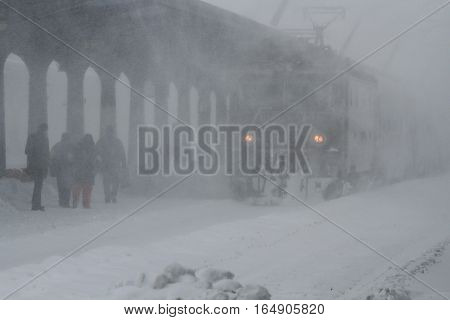 Bucharest Romania January 29 2014: People are waiting for a train in Gara de Nord main railway station during a blizzard.