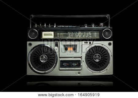 Vintage silver radio boom box on black background