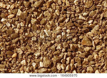 Pile Of Orange Toned Gravel Stones.