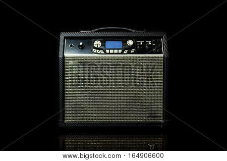 Guitar amp on a black background .