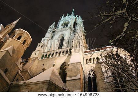 Munich Germany - December 31 2014: view of front fragment of Saint Paul's Church at night in winter time on December 31 2014 in Munich Germany.