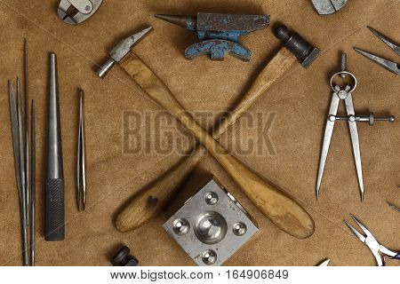 Tools Of Jewellery. Jewelry Workplace On Leather Background. Hammers, Anvil, Divider Compass. Top Vi