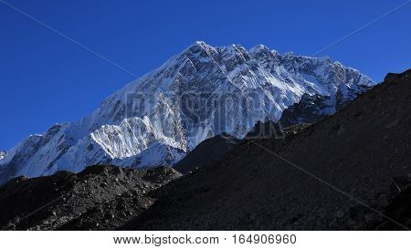 High mountain in the Everest National Park. Mount Nuptse view from Lobuche.