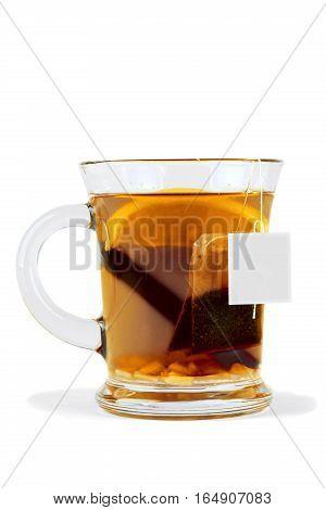 Glass of Tea with Tea Bag and Cinnamon Stick