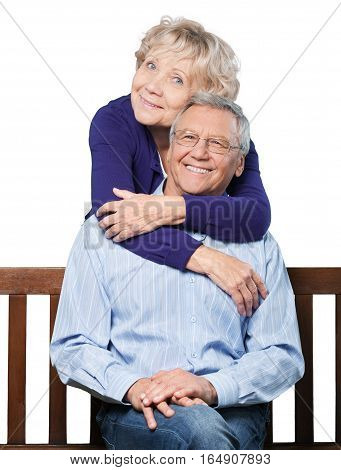 Portrait of a Mature Couple Embracing on the Bench
