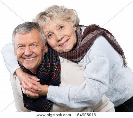 Portrait of a Senior Man Giving Woman Piggyback Ride