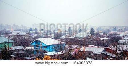 Snow falling down over the Giurgiu city, Romania.