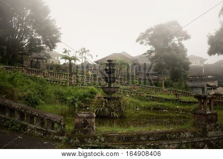 Abandoned and mysterious hotel Bedugul Taman in the fog. Indonesia. The Island Of Bali