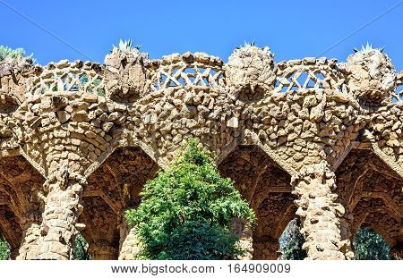 Arcade of stone columns in Park Guell, built by Gaudi, Barcelona Spain
