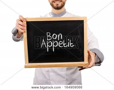 chef with bon appetit text on blackboard