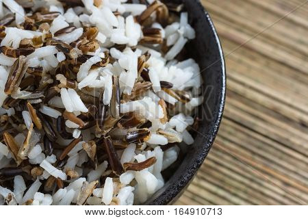 Mix of cooked native North American Indian wild rice and boiled long grain rice