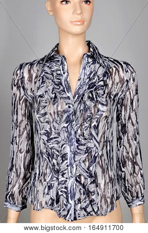 Women's blouse in abstract drawing on a mannequin. isolated on gray background