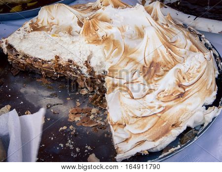 meringue torte cake with a slice out of it
