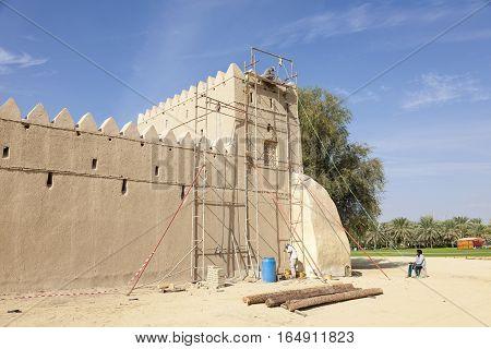AL AIN UAE - NOV 29 2016: Restoration works on the historic Al Jahili fort in Al Ain. Emirate of Abu Dhabi United Arab Emirates