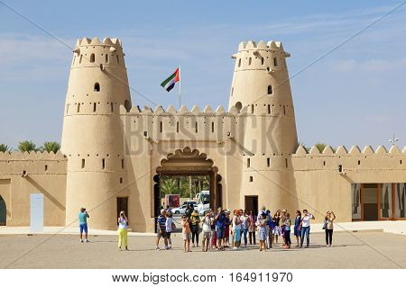 AL AIN UAE - NOV 29 2016: Tourist grop at the historic Al Jahlili fort in Al Ain. Emirate of Abu Dhabi United Arab Emirates