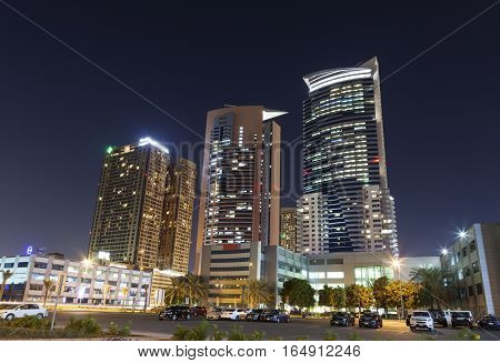 DUBAI UAE - NOV 29 2016: Skyscrapers at the Dubai Internet City illuminated at night. United Arab Emirates Middle East
