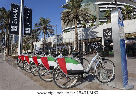 DUBAI UAE - NOV 30 3016: Rental bikes in Dubai downtown. United Arab Emirates Middle East