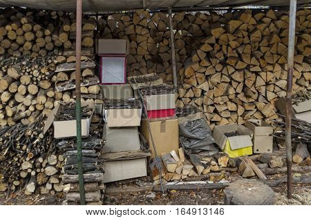 Stack of full round firewood and broken branch different  size for facile kindle in winter